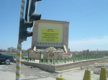 "It reads, in English letters over the Arabic, of course: ""The United States Army in partnership with the Iraqi people for a better future."" I don't believe that sign is still standing..."